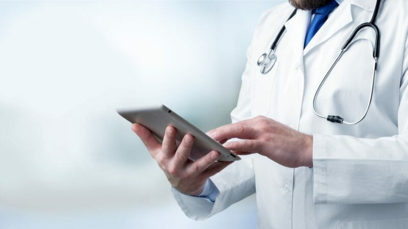 Medical doctor works off an electronic pad