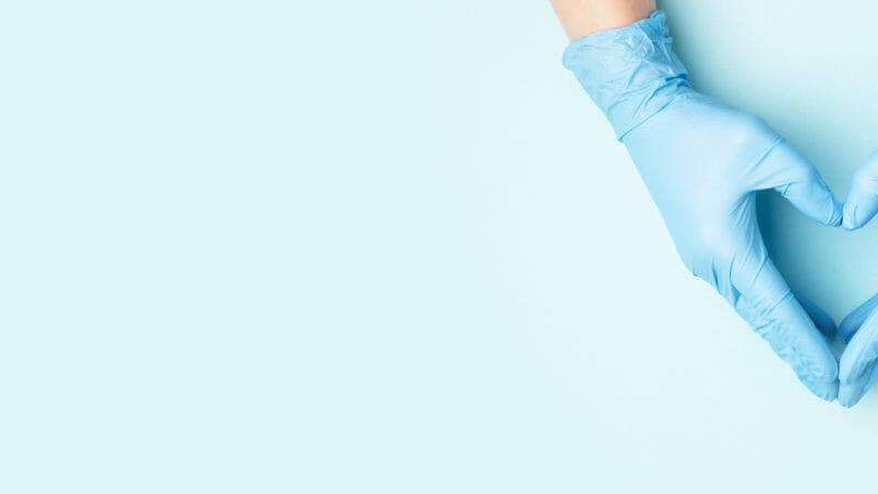 Hand in medical gloves.
